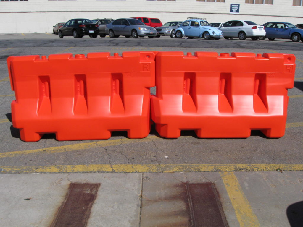 two orange k-rail barriers